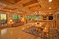 Is it even possible for a dream kitchen to be cozy? Only in the Great Smoky Mountains! Complete with wood furnishings, plenty of seating, and a rustic chandelier, the Southern Elegance cabin is the perfect spot for a family dinner or your morning coffee #GreatSmokyMountains #cabin #Tennessee #rusticelegance #woodfurnishing #mountianhome #beautifulview