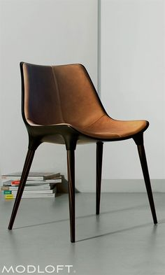 The beautiful Langham dining chair by Modloft is made with steel core legs finished in Brazilian ebony veneer, a bucket seat made of fiberglass finished in black matte, and upholstered in distressed caramel genuine leather. Room Chairs, Table And Chairs, Office Chairs, Lounge Chairs, Eames Chairs, Kitchen Chairs, Modern Furniture, Furniture Design, Brown Furniture