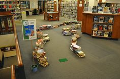Swinging thru the Stacks.  Mini Golf fundraiser idea for libraries. Lots of pictures from this event for different hole ideas.