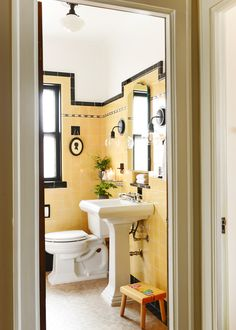 A few simple steps is all it takes to get your vintage bathroom from dated to adorable! Check out our black and yellow tile bathroom makeunder with Lowe's! Bathroom How To Refresh a Vintage Bathroom + Keep the Charm: II of II Yellow Bathrooms, Vintage Bathrooms, Modern Bathroom, Small Bathroom, Bathroom Ideas, Condo Bathroom, Bathroom Cabinets, Vintage Bathroom Lighting, Yellow Bathroom Decor