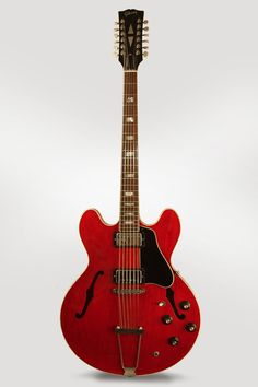 Gibson ES-335-12 Model 12 String Semi-Hollow Body Electric Guitar (1967), made in Kalamazoo, Michigan, serial # 120370, cherry lacquer finish, Laminate maple body, mahogany neck, rosewood fingerboard, original black hard shell case.  Gibson's first single-neck electric 12-string ES-335-12 was introduced in mid-1965.  Retrofret - New York String Service