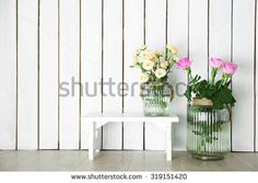 Home decor and roses on wooden background