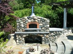 Outdoor Kitchens BBQs Pizza Ovens Photo Gallery by Custom Fence and Masonry Seattle, Redmond, Bellevue, Kirkland WA Pizza Oven Outdoor, Outdoor Cooking, Outdoor Kitchens, River Rock Fireplaces, Outside Fireplace, Outdoor Fire, Outdoor Living, Bread Oven, Outdoor Buildings