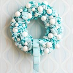 Use white ornaments and turquoise ribbon to complete our festive Tiffany Blue Wreath! More creative Christmas wreaths: http://www.bhg.com/christmas/wreaths/christmas-wreaths/?socsrc=bhgpin103012tiffanybluewreath#page=10
