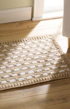 """Hearth & Home Rug - Bring interesting texture to a space with a contemporary crocheted rug.   Choose any two colors that blend or contrast with your décor. If placed   on hard flooring, use it with a non-slip rug pad for safety. RHSS Chunky: 3 sks Buff A, 1 sk White B  Crochet Hook: 9mm [M-13 US]  Rug measures 38"""" wide; 24"""" long  free pdf"""