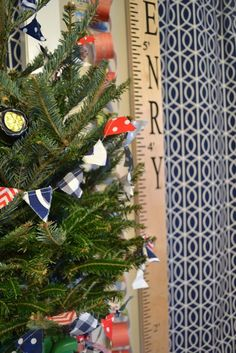 Simple and preppy decor for a live Christmas tree in a child's room.