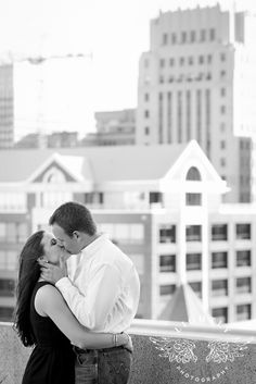 Sundance Square in Down town Fort Worth, Kisses, Black & White,  City Background, Love, Weddings, Engagements, Ideas, Poses, Black Dress, Jewelry, Sweet, Roof top Photographed by Lightly Photography Dallas Fort Worth area photographer. Lightlyphoto.com