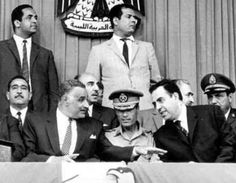 In the wake of the 1969 Libyan coup, the presidents of Egypt (left, Gaddafi's childhood hero Nasser) and Syria (right) meet with Colonel Gaddafi (center, ...