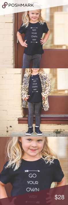 Go your own way ↗️ basic black graphic tee Go your own way. ❤️ Great for your little boy, or girl or an AMAZING gift for a new mom to be. Add a super cute vest or a flannel shirt on top to really spruce this cute trendy tee up.   Sizes available: 2T, 3T, & 4T. Unisex short sleeved t-shirt top.   Prices are firm. Bundle 2 or more items to receive 10% off your purchase.   All images are used with permission from the vendor. Boutique Shirts & Tops Tees - Short Sleeve