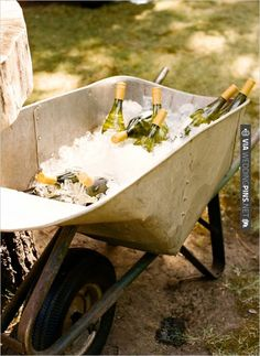 wine in vintage wheel barrel | CHECK OUT MORE IDEAS AT WEDDINGPINS.NET | #weddingfood #weddingdrinks