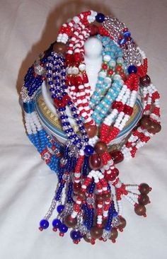ORISHA ARTS - Mazos for the Ibejis. They are made using the bead and color patterns for Yemaya and Shango, the twins' parents.
