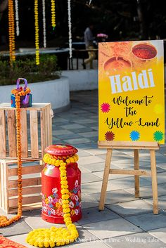 This bride's carnival-themed poolside mehndi celebrated the vibrant Rajasthani culture replete with folk dancers and live bangle makers. Wedding Hall Decorations, Desi Wedding Decor, Wedding Entrance, Backdrop Decorations, Indian Wedding Favors, Board Decoration, Mehndi Decor, Indian Wedding Photography Poses, Wedding Photo Props