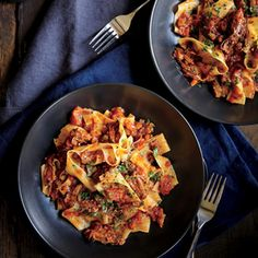 Short Rib and Tomato Ragout Recipe Main Dishes with olive oil, bone-in short ribs, kosher salt, ground black pepper, finely chopped onion, carrots, chopped celery, garlic cloves, water, tomato paste, dried basil, dried oregano, tomatoes, pappardelle