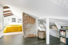 Look what a pop of color can do to a room, wonders! Of course, if chosen properly. Erick Olson The post Attic bedroom with a touch of yellow appeared first on Daily Dream Decor. Attic Bedroom Small, Attic Bedrooms, Attic Spaces, Bedroom Loft, Loft Beds, Upstairs Bedroom, Attic Bathroom, Open Spaces, Master Bedrooms
