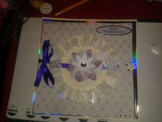 new to craft and have started making cards... Tattered lace flower die, Tonic circle and paper from Dream Catcher....