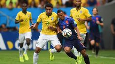 PHOTO: Paulinho of Brazil and Jonathan de Guzman of the Netherlands compete for the ball during the 2014 FIFA World Cup Brazil Third Place Playoff match between Brazil and the Netherlands at Estadio Nacional on July 12, 2014 in Brasilia, Brazil.