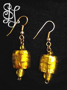 Safari Amber Glass Earrings (from the Safari Collection) each feature a single dark or light amber glass bead with two small accent beads for $20 at Sasha L Jewels LLC. #jewelry #earrings #gold
