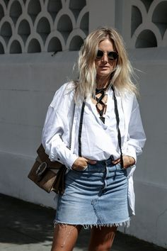 lace up urban shirt underneath white button up, tucked in and sleeves rolled, ripped jeans