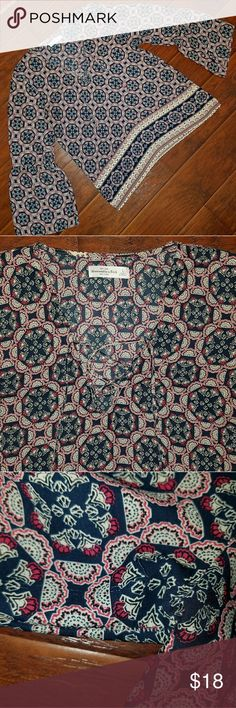 Abercrombie & Fitch Lace Up Top Abercrombie & Fitch Lace Up Top  Size Large Great uses condition, some minor pulling in fabric as seen in the last photo Bell sleeves  This top is also available in a black/green floral print that is listed in my closet. Abercrombie & Fitch Tops