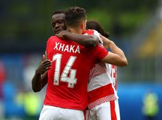 Taulant Xhaka of Albania and Breel Embolo of Switzerland hug after the UEFA EURO 2016 Group A match between Albania and Switzerland at Stade Bollaert-Delelis on June 11, 2016 in Lens, France.