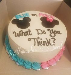 Adorable Mickey and Minnie themed cake for a gender reveal party