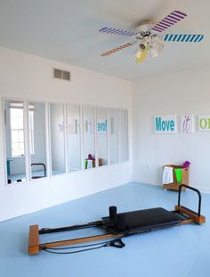 Make a Wall of Mirrors: Mirrors in the gym aren't just great for showing off your new workout outfit (although that is pretty nice too). Adding a few full-length mirrors will make a tiny space feel double the size and more like a real gym. (via In My Own Styl