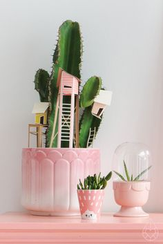sagaform greenhouse. Adorable plant arrangement. Pink. Green. Cactus with tree houses.
