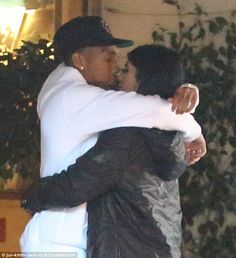 Kylie Jenner and Tyga can't stop kissing while waiting for their Rolls-Royce | Daily Mail Online