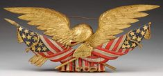 Lot 2107. AMERICAN CARVED AND DECORATED EAGLE PLAQUE BY C. H. BADGER, 1898. (92555)