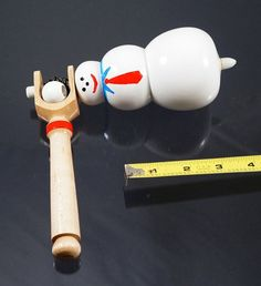 Toy top. Wood spinning top with handle. Snowman top on Etsy, $20.00