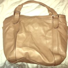 NEW Merona purse Brand New without tags Merona bag I tan/beige with silver metal detail. Has two deep side pockets, interior pockets with zipper pocket. Can fit almost anything in this bag! Merona Bags