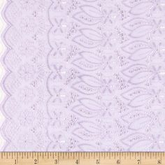 """Fancy Eyelet Lilac from @fabricdotcom  This deeply embroidered eyelet has a scalloped edge on both ends (also known as a ''Galloon"""" embroidery). Great for blouses, dresses , fuller skirts and even home décor."""