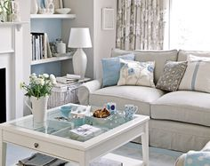 love the lightness of the room  the bookshelves with the blue background!