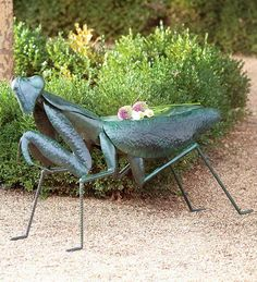 "Praying Mantis Handmade Iron Garden Stool...The Praying Mantis is named for the way its legs fold in ""prayer,"" and ""mantis"" comes from the Greek word for Prophet. Given that, it should be the sweetest bug ever, right? Not so much. Fierce predators, they kill and eat mice, snakes, even hummingbirds (graphic videos on YouTube). A form of Kung Fu is called Praying Mantis in its honor. Oh, and while mating, the female bites off the male's head. Sweet bug, indeed!"