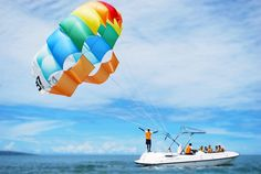 "A beautiful day out to be parasailing....when was the last time you got some ""Air Time""?"