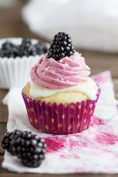 BLACKBERRY White Chocolate Cupcakes topped with white chocolate and blackberry buttercream #simple #cupcake #recipes http://thecupcakedailyblog.com/blackberry-white-chocolate-cupcakes/
