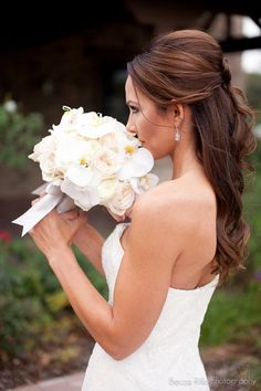Bride will carry a clutch bouquet of cream hydrangeas, Picasso calla lilies, white garden roses, white lisianthus, white phalaenopsis orchids, white tulips, and gold succulents wrapped in ivory ribbon