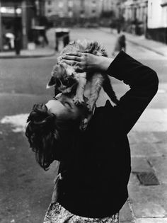 Everybody Needs A Little Love Every Day. Girl with Cat. Southam Street, London. 1957. Photographer: Roger Mayne