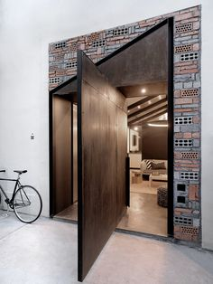 An assortment of exposed recycled brick, concrete, and raw metal reflect the former residential structures in the Shanghai neighborhood where Herschel Supply's office by Line house was built this year. Interior Design Magazine, Interior Design Examples, Best Interior Design, Interior Design Inspiration, Interior Design Living Room, Room Interior, Big Doors, Pivot Doors, Windows And Doors