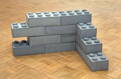 """Concrete Legos - Andrew Lewicki - 2010 -  Concrete - 15.5"""" x 7.75"""" x 5.5"""" - Set of 12 (Edition of 5 installation variable) - This installation - named 'Concrete Legos' - was created by artist Andrew Lewicki, based in Los Angeles, back in 2010. These concrete LEGO bricks stack together just like their plastic counterparts. One way to illustrate the transition to adulthood keeping your child's soul?"""