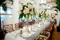 White flower arrangement with roses and hydrangea by Botanica. Gasparilla Inn White and Green Dining Room Wedding #wedding #weddingflowers #Botanica Photography by: http://www.unruephoto.com/