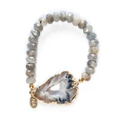 Bliss indeed...Gorgeous smoky laboradite faceted beads are paired with a natural color druzy agate to create this beautiful white-sands worthy design. The soft shades combined with tactile polished stones make this eye catching yet sweet. We need several!   Details and Dimensions: Smoky Labarodite beads combined with large semi precious agate stone plated on edges in 14K gold. Please note that each agate is one of a kind and color varies from black/grey to natural/tan. All have sparkling ...
