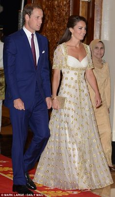 Every inch the fairytale princess: William and Kate arrive at an official dinner given by His Majesty The Agong at his official residence
