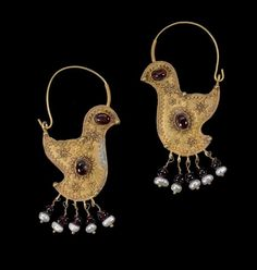 A pair of gold hoop Earrings. Greater Syria or Persia, 10th Century.