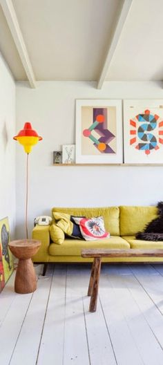 This collection of vibrant rooms from Blogger Audrey, of This Little Street, were designed with kids and grown-ups in mind. This open living room uses modern wall art in bright colors that will appeal to every member of your family. Check out the rest of Audrey's post to see how you can get this look today.