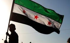 The pre-Ba'ath-regime flag of Syria between 1932 and 1958 has been adopted by Syrian revolutionaries of the Syrian uprising that began in 2011. (Picture: AP)