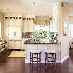 Love the dark hardwood contrast with the white cabinets