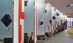 "Below the mural, a ""sawtooth"" wall welcomes students with one of KIPP NYC's motivational phrases, ""Go. Graduate."" (Photo: Garrett Rowland)"