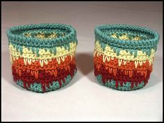 """""""Himalayan Baskets"""" made in worsted weight yarn. Both are 4.75"""" tall. The left one is 5"""" across and the right one is 4.5"""" across."""