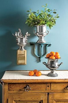 Deploy Old Objects in New Ways - 50 Best Small Space Decorating Tricks We Learned in 2016 - Southernliving. Find creative ways to use objects that you already have. A gorgeous set of antique champagne buckets? Affix them to the wall and use them for flatware storage, as planters for flowers, or as graphic art. When in doubt, go vertical and take advantage of wall space in small rooms.